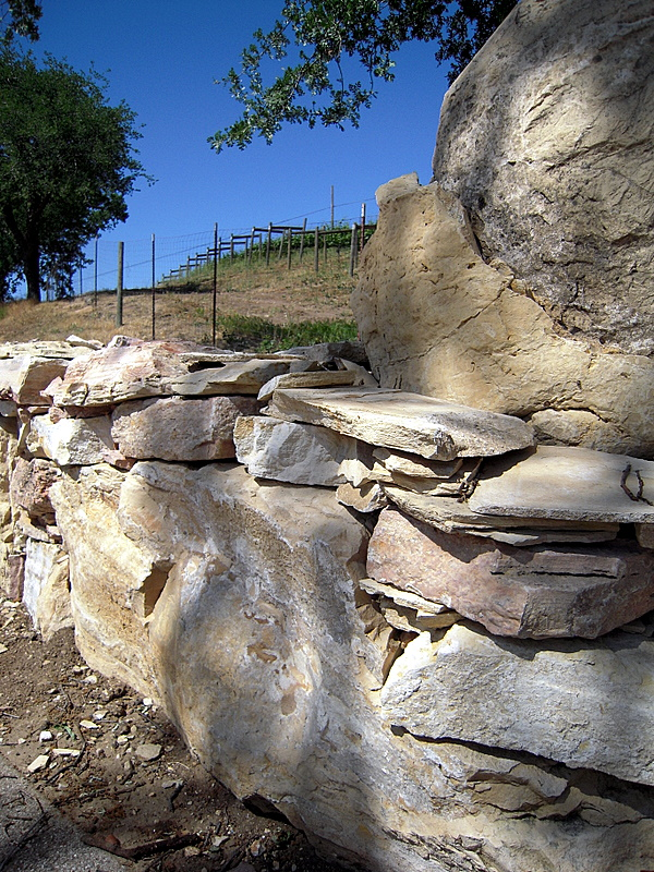 limestone wall on approach to Adelaida tasting room