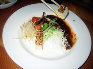 eating Sanraku spicy tofu appetizer