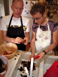 John and Aleks happily working together in the kitchen