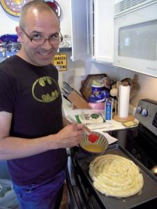 brushing yogurt dressing over borek prior to baking
