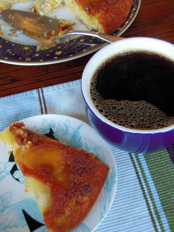 enjoying apple upside down cake with black coffee for breakfast