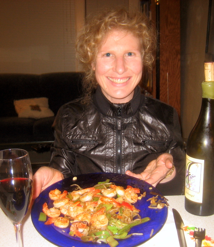 enjoying simple shrimp stir fry with a glass of wine