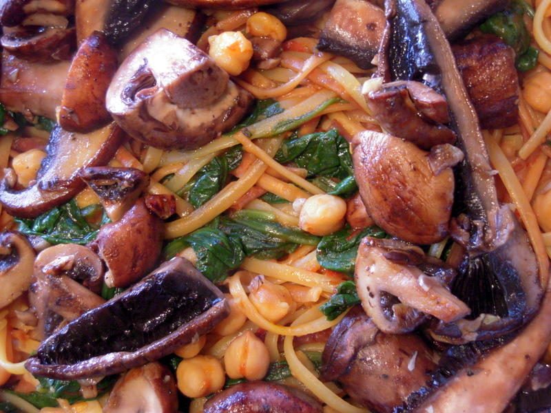 linguini with harissa, chick pea, mushroom and spinach close up