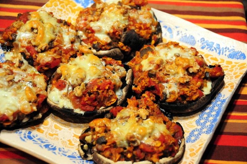 baked Portobello mushrooms stuffed with mushroom oat tomato filling with walnuts, Fontina and parmesan