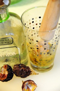 muddling passion fruit seeds and pulp with sugar