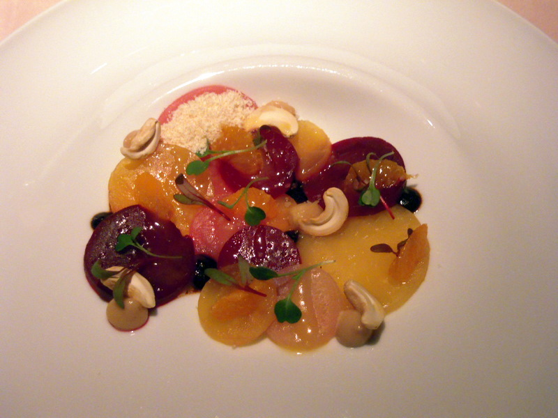 roasted beets with cashews and mandarins, black garlic puree