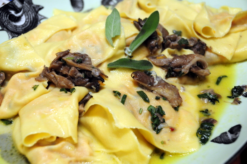 ravioli stuffed with pumpkin and shitake in sage and trumpet mushroom sauce