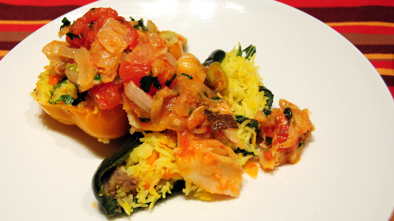 black hummus and saffron rice-stuffed poblano and sweet bell peppers with salt cod topping