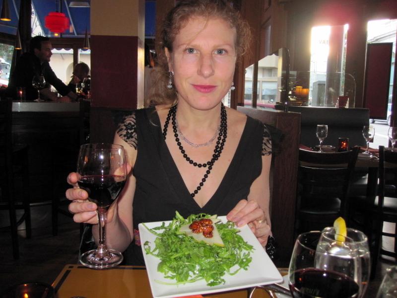 enjoying French wine and arugula salad at Garçon!