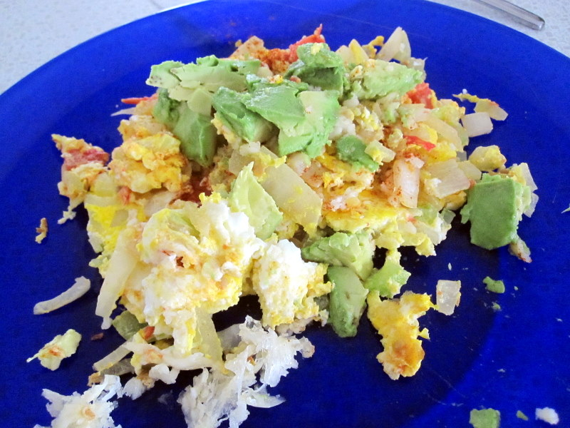 spicy scrambled eggs with onion, garlic, celery, tomato and avocado