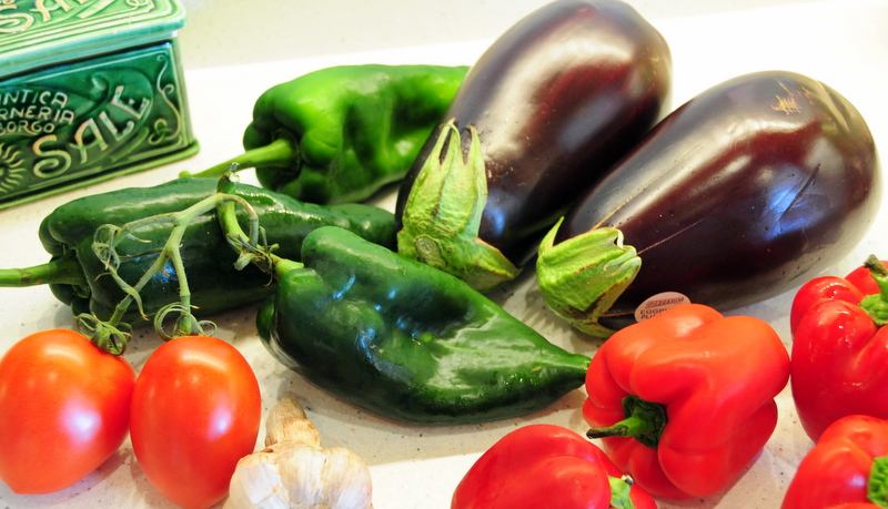 key ingredients for poblano peppers stuffed with Italian eggplant, anchovy and pepitas