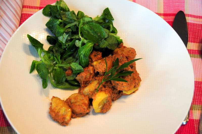 kabocha pumpkin gnocchi with walnut pesto with a side of mache salad