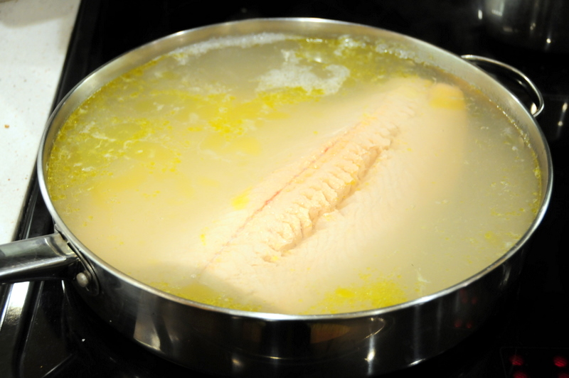 king salmon poaching in lemon grass court bouillon