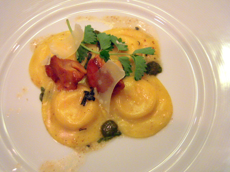 lovely cheese-filled ravioli with basil pesto and tomatoes