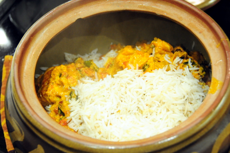 several layers of rice and fish to form my biryani