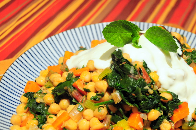 sautéed chickpeas with Swiss chard, spinach and labneh sauce