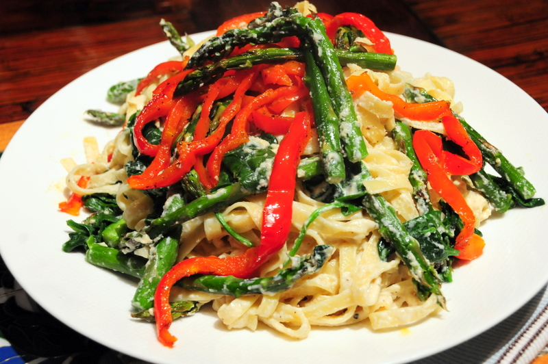 black pepper fettuccine in chardonnay cashew nut sauce with asparagus, red bell pepper annd spinach