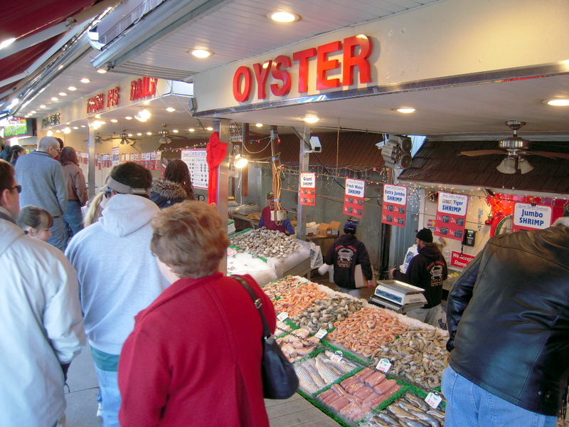 crowds of seafood shoppers throng the pier