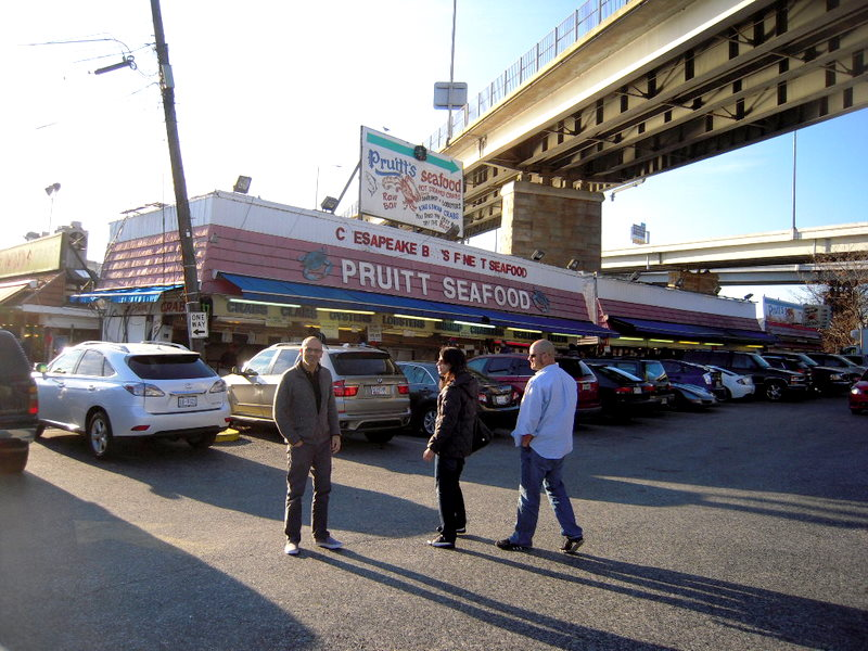 the crew in front of Pruitt's Seafood.  See the Freeway overpass