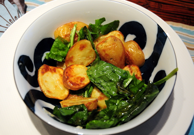 roasted baby potatoes with fresh sorrel leaves