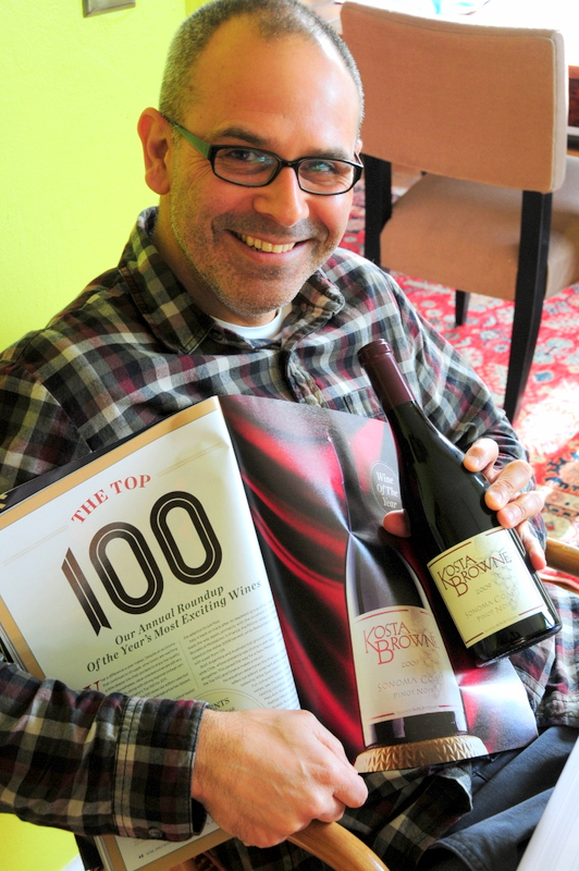 Hegui holding our bottle of Wine Spectator's 2011 wine of the year with the magazine article about Kosta Browne