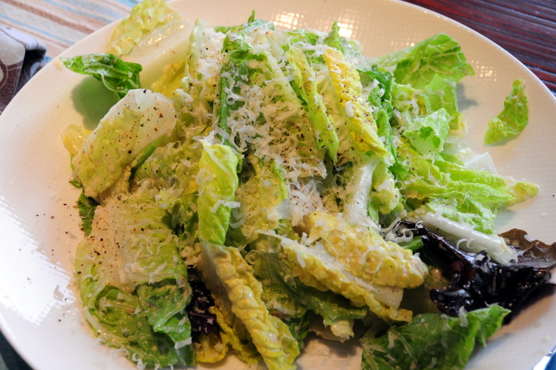 Romaine and oak lettuce salad in zippy improv Caesar dressing