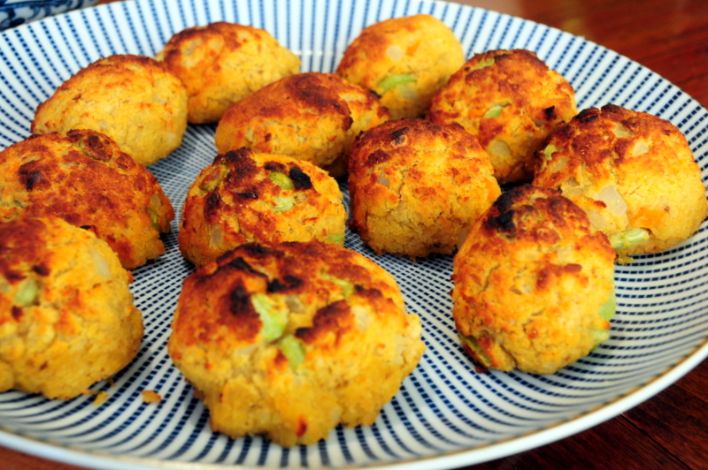 large plate of baked red lentil croquettes