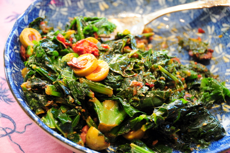 spicy mixed greens in tomato, olive garlic sauce
